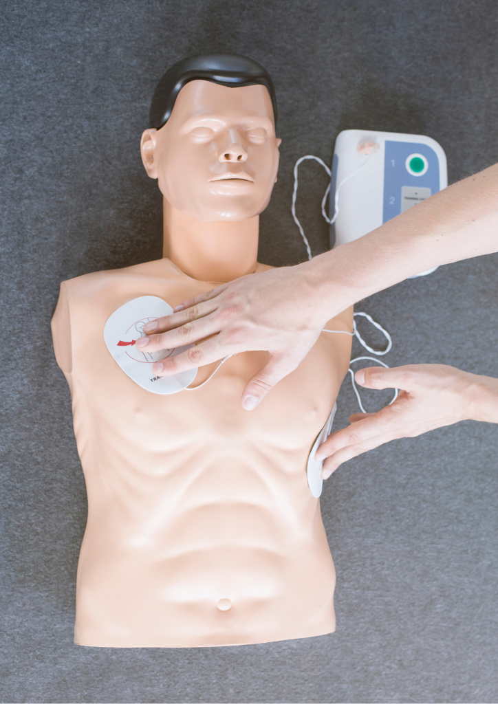 Image showing AED for BLS training on manikin chest